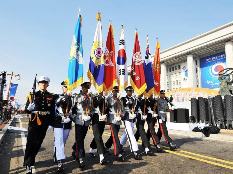 Members of a South Korean honour guard march during a rehearsal for the inauguration of President-elect Park Geun-Hye at the National Assembly in Seoul. (AFP)