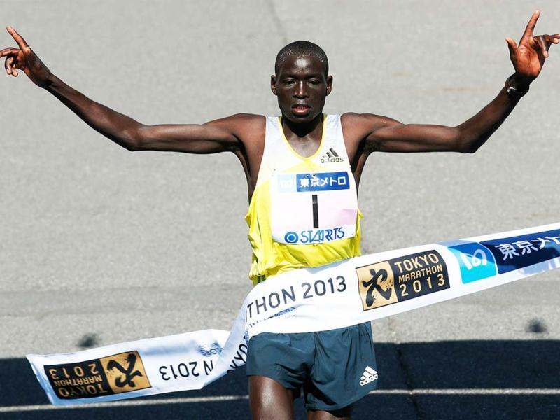 Dennis Kimetto of Kenya crosses the finish line to win the men's race of the Tokyo Marathon in Tokyo. (AP)