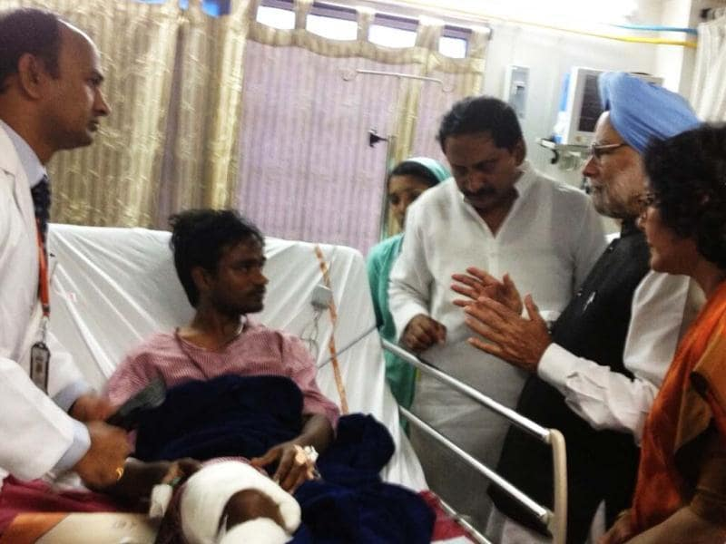 Prime Minister Manmohan Singh is seen speaking with blast victim during his Hyderabad visit. Photo Courtesy: PMO India