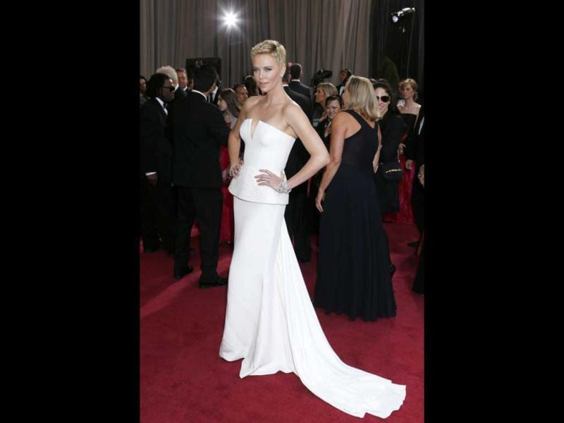 Actress Charlize Theron arrives at the Oscars at the Dolby Theatre on Sunday Feb. 24, 2013, in Los Angeles. AP Photo