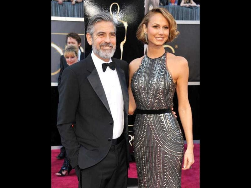 Actor George Clooney, left, and Stacy Keibler arrive at the Oscars at the Dolby Theatre on Sunday Feb. 24, 2013, in Los Angeles. AP Photo