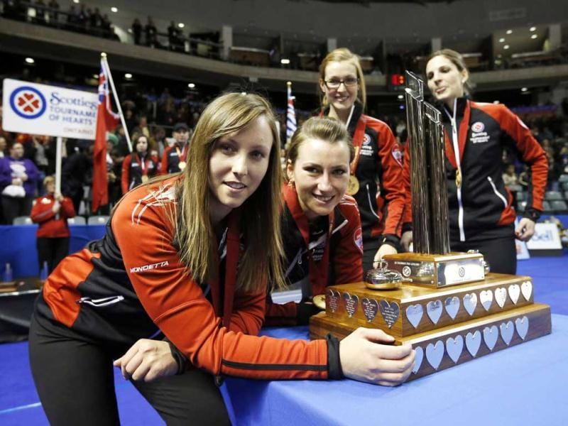 Ontario skip Homan, Miskew, Kreviazuk, Weagle pose with the trophy after winning their gold medal game at the Scotties Tournament of Hearts curling championship in Kingston. (Reuters)