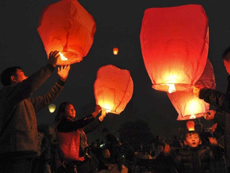 People launch sky lanterns into the sky in celebration for the Lantern Festival in Fuyang. (Reuters)