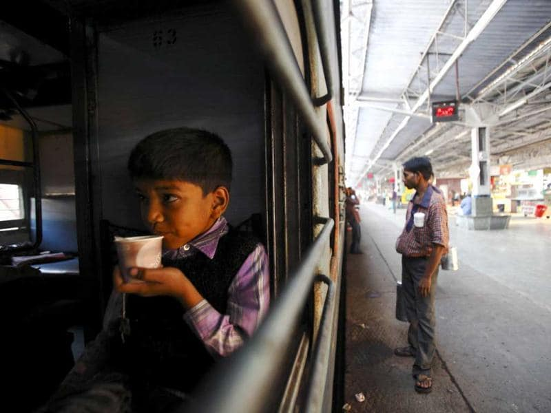 A boy drinks tea inside a train at Agra Cantt Railway Station. (Reuters)
