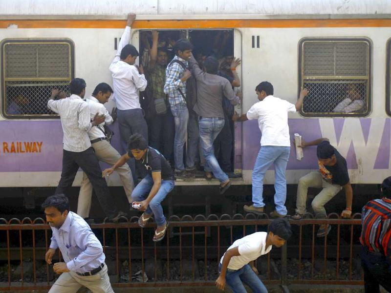 Commuters disembark from a crowded train in Mumbai. Railway minister Pawan Kumar Bansal presented the rail budget for next fiscal year in the parliament. Indian railway network is one of the world's largest, with some 14 million passengers daily and some 64,000 kilometers (40,000 miles) of railway track cut through some of the most densely populated cities. AP Photo