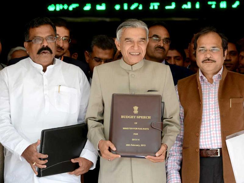 Railway minister Pawan Kumar Bansal (C) carries his Budget Speech as he walks towards Parliament to present the Indian Railway budget 2013-14, accompanied by deputy railway ministers J Surya Prakash Reddy (L) and Adhir Ranjan Chowdhury in New Delhi. AFP PHOTO