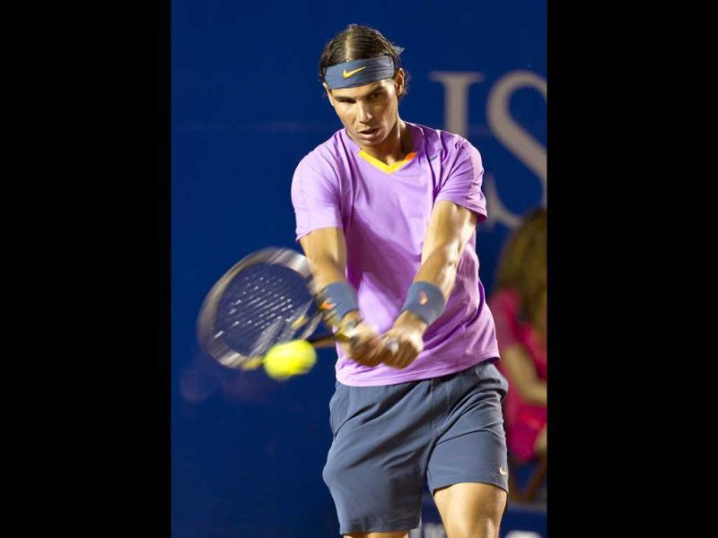 Rafael Nadal returns the ball to Argentina´s Diego Scwartzman during the Mexican Open Tennis in Acapulco, Mexico. AP Photo