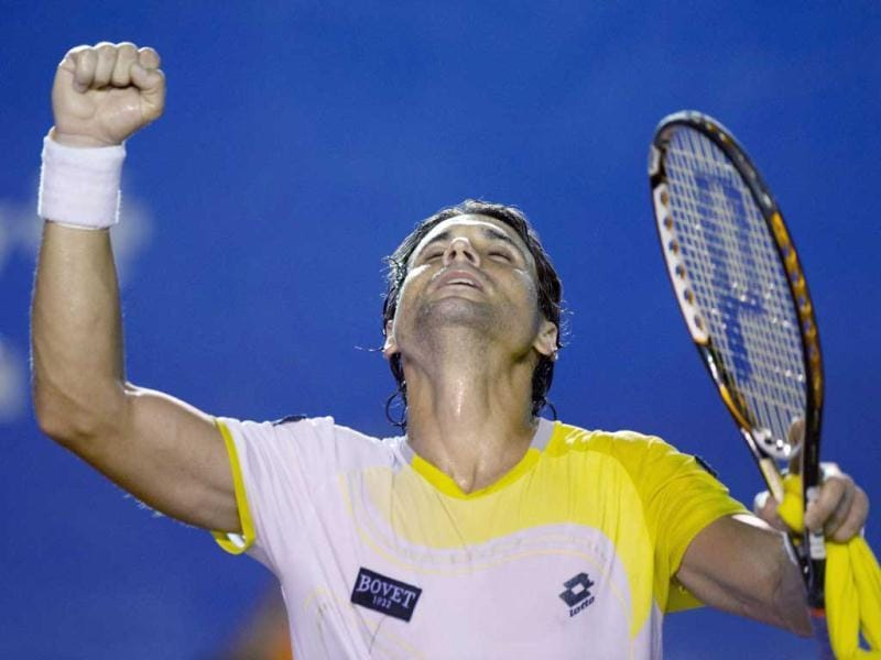 David Ferrer of Spain celebrates after winning over Croacia's Antonio Veic during the Mexico ATP Open men's single tennis match, in Acapulco, Guerrero state. AFP photo
