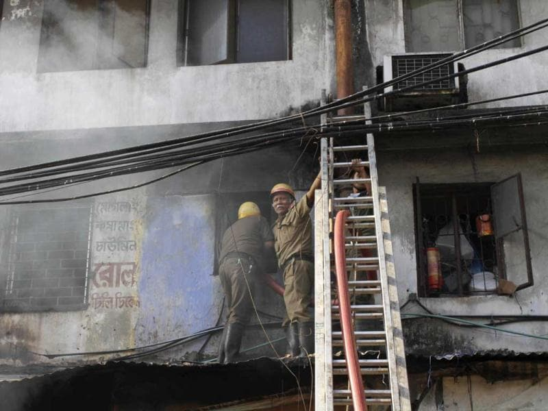 Firemen try to douse fire that broke out early morning at an illegal six-story plastics market in Kolkata. AP photo