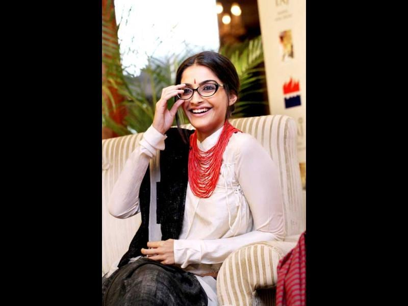 Sonam Kapoor poses with her glasses on at Anuja Chauhan's book launch recently in the capital. See more pics of the fashionista who is shooting in Delhi these days.