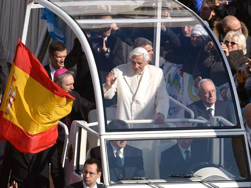 Pope Benedict XVI waves as he arrives on St Peter's square for his last weekly audience. He bid an emotional farewell at his last general audience acknowledging the