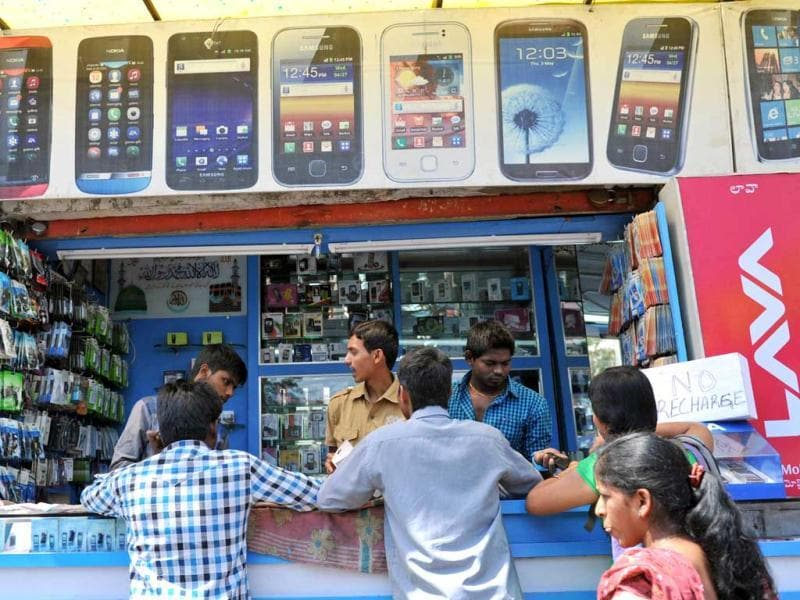 Customers throng a mobile phone shop in Hyderabad as the Union Budget is presented in the Lok Sabha. AFP photo