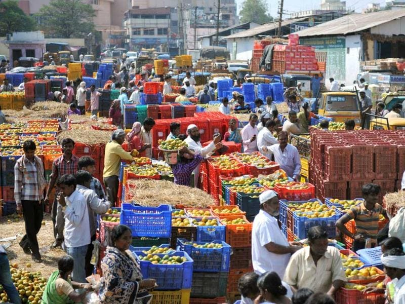 Traders at the Gaddiannaram fruit market in Hyderabad as the finance minister presented the Union Budget 2013-14 in the Lok Sabha. AFP photo