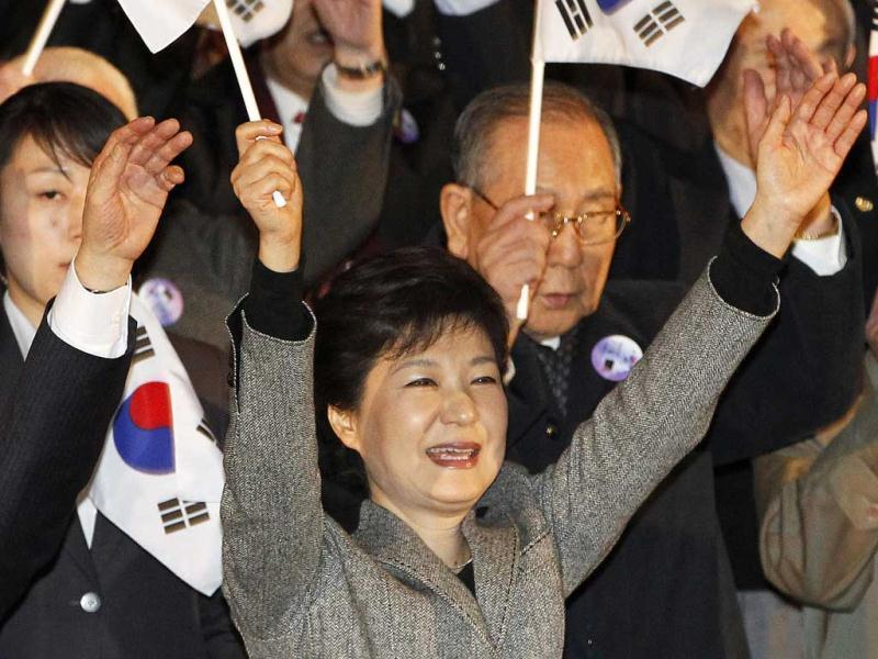 South Korean President Park Geun-hye gives three cheers with a national flag during a ceremony to celebrate the March First Independence Movement Day, the anniversary of the 1919 uprising against Japanese colonial rule, in Seoul. AP