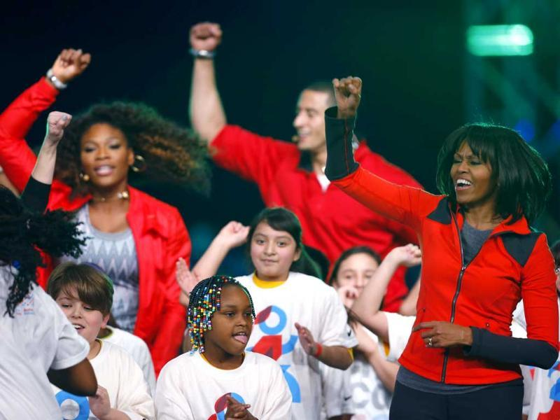 Tennis player Serena Williams, San Francisco 49ers quarterback Colin Kaepernick and US first lady Michelle Obama dance on stage with school children during an event to bring physical activity back to schools, in Chicago, Illinois. Reuters/Jeff Haynes
