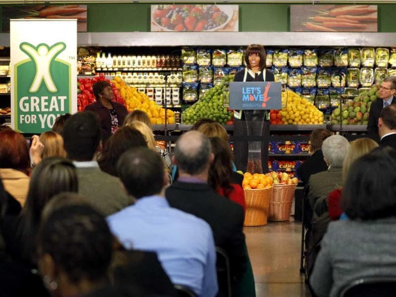 First lady Michelle Obama speaks at a Walmart Neighborhood Market in Springfield. Obama was promoting her campaign against childhood obesity and highlight