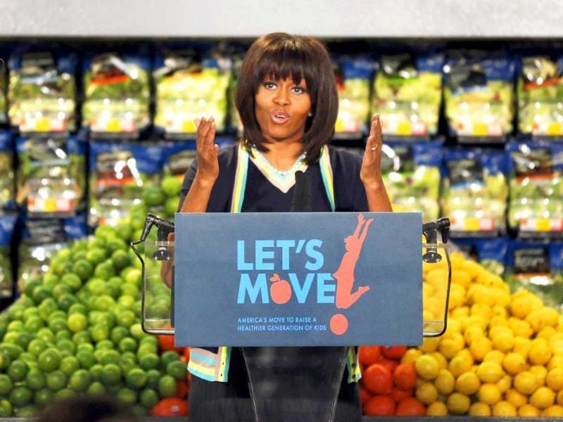 First lady Michelle Obama speaks to a small crowd at a Walmart Neighborhood Market in Springfield. Obama was promoting her campaign against childhood obesity. AP/Orlin Wagner
