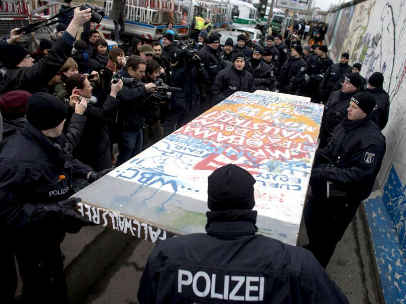 Police carry away a protester's styrofoam copy of a segment of the Berlin Wall in Berlin. District chairman Franz Schulz told Bild newspaper that the section of the wall is being removed to allow access to a new luxury apartment building planned for the banks of the Spree river. Reuters/Thomas Peter