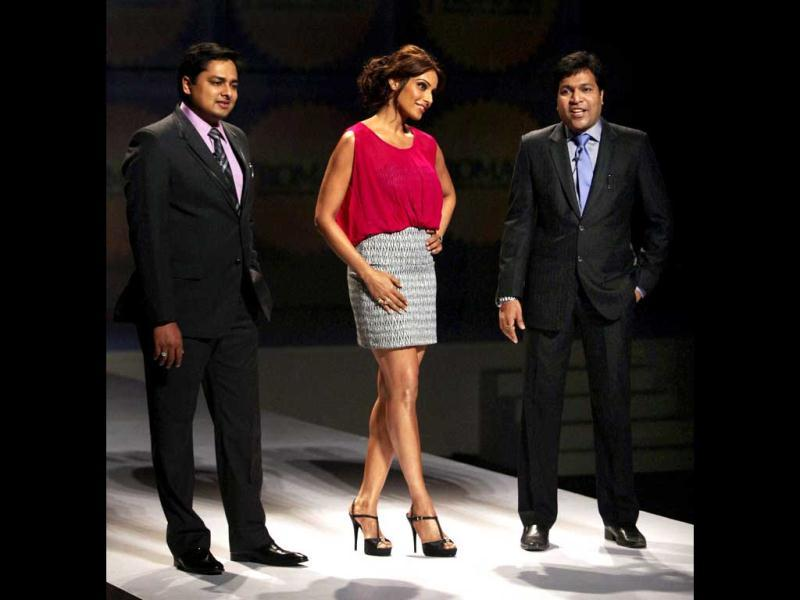Bipasha Basu walks the ramp with Promoter and Managing Director, Promart Retail India, Ashish Garg and CEO & Director Punit Agarwal at the event. (PTI Photo)