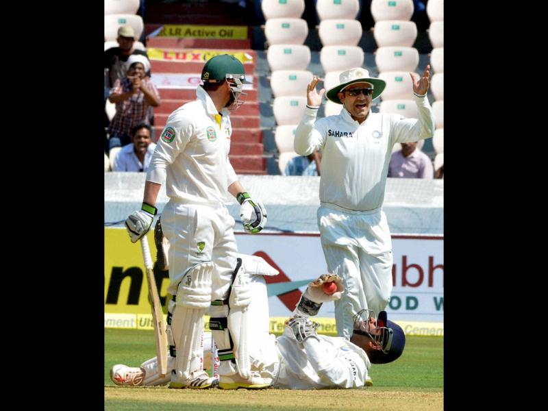 Virender Sehwag celebrates the dismissal of Australia's P Hughes during the 2nd cricket Test match in Hyderabad. (PTI Photo)