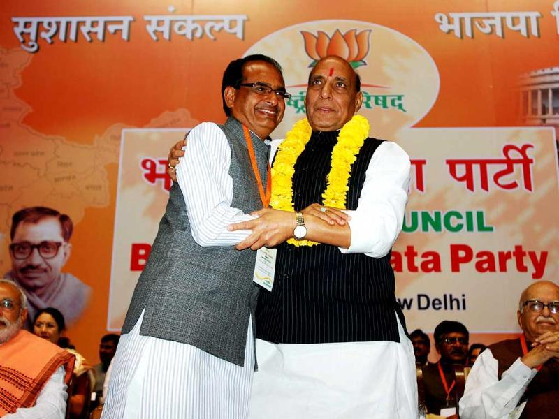 BJP president Rajnath Singh being honoured by Madhya Pradesh chief minister Shivraj Singh Chauhan with a garland at the BJP National Council meeting in New Delhi. UNI