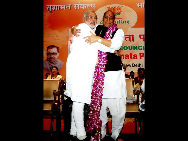 BJP president Rajnath Singh hugs Gujarat chief minister Narendra Modi after being honoured with a garland at the BJP National Council meeting in New Delhi. UNI