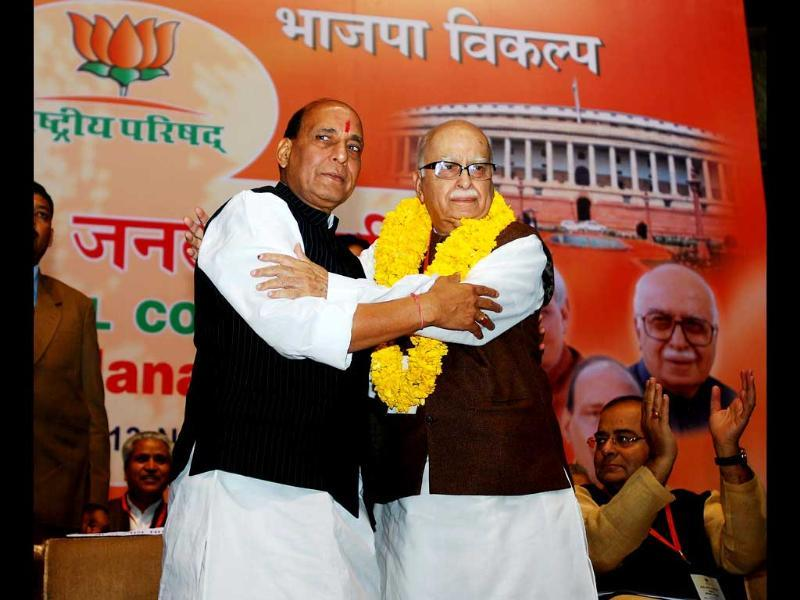 Senior BJP leader LK Advani being received with a garland by party president Rajnath Singh at the BJP National Council meeting in New Delhi. UNI