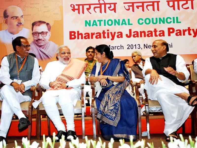 Madhya Pradesh chief minister Shivraj Singh Chauhan, his Gujarat counterpart Narendra Modi, Opposition leader in Lok Sabha Sushma Swaraj and BJP president Rajnath Singh at the BJP National Council meeting in New Delhi. UNI