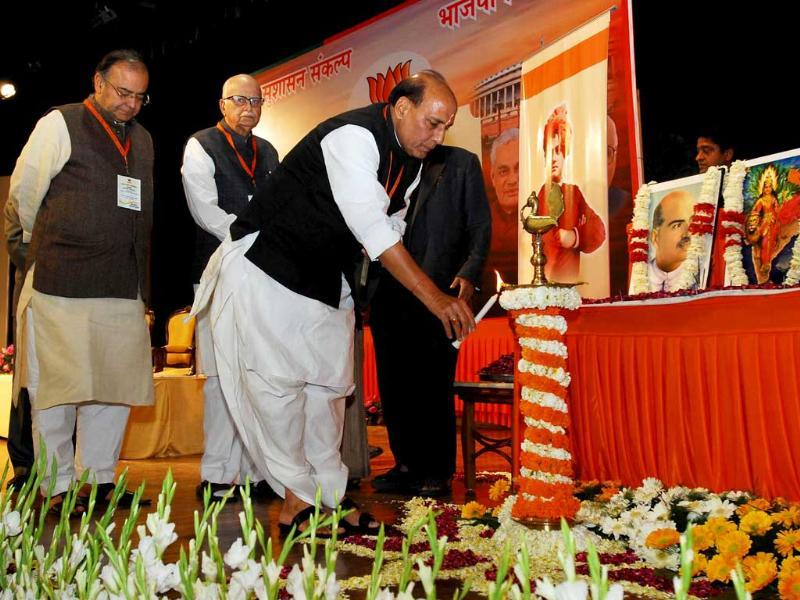 BJP president Rajnath Singh lighting the ceremonial lamp at the BJP National Executive meeting in New Delhi. UNI