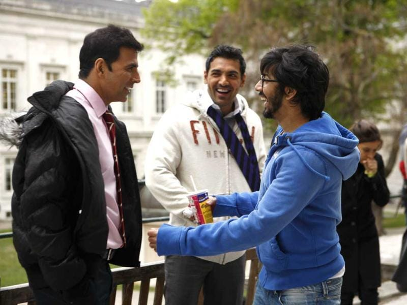 Rohit Dhawan, David Dhawan's son, explains a scene to his Desi Boyz star cast John Abraham and Akshay Kumar