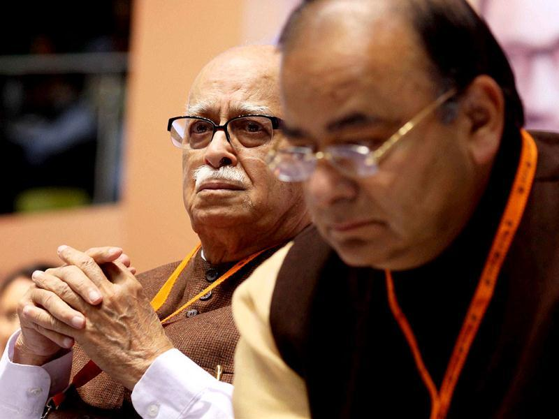 Senior BJP leader LK Advani gets emotional while Arun Jaitley looks on during the party's National Council meeting in New Delhi. PTI photo