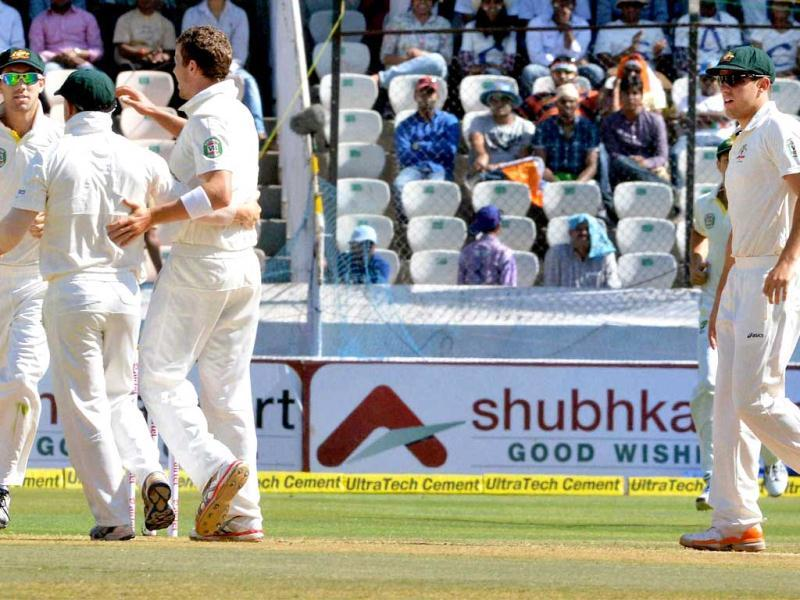 Australian players celebrate the dismissal of Virender Sehwag during the second day of their second test match in Hyderabad. PTI photo