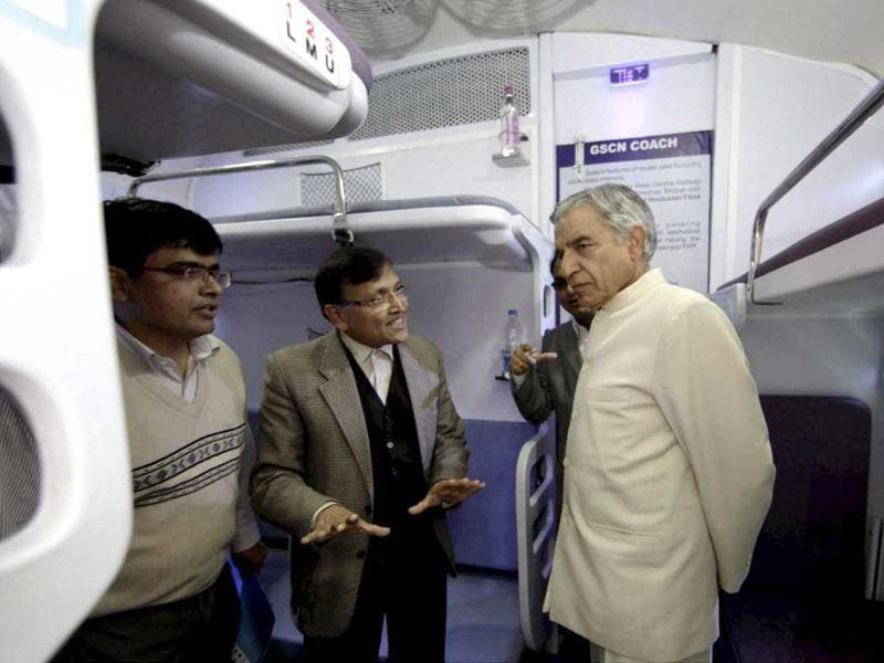 Railways minister Pawan Kumar Bansal inspects a modern coach 'Anubhuti' at a railway coach care centre, in New Delhi. The coach will provide higher travel comforts to passengers. PTI/Vijay Verma