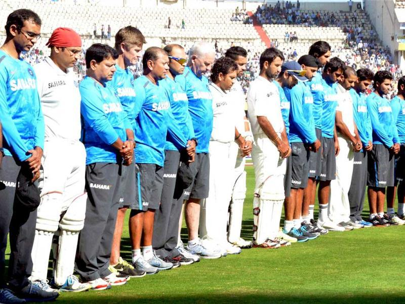 Players pay tribute to the victims of the recent twin blasts before the start of the 2nd day of the 2nd Test match between Indian and Australia in Hyderabad. PTI photo
