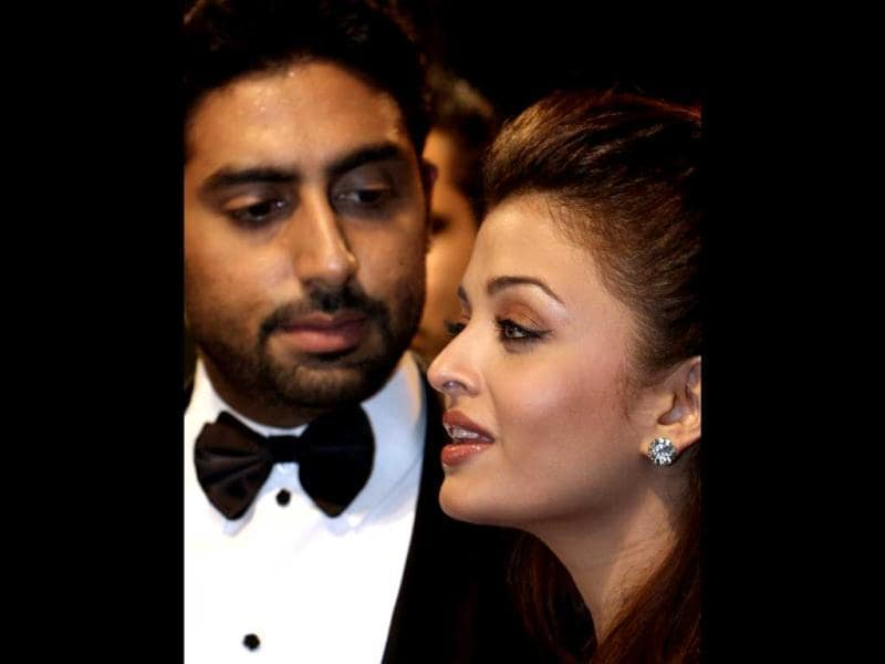 Abhishek Bachchan (L) watches his actor-wife Aishwarya Rai-Bachchan speak to the media on arriving at the International Indian Film Academy (IIFA) Awards 2008 ceremony in Bangkok on June 8, 2008. AFP Photo