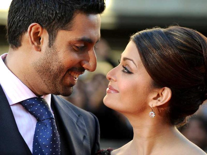 Aishwarya Rai Bachchan (R) and husband Abhishek Bachchan attend the world premier of Raavan in London, on June 16, 2010. AFP Photo