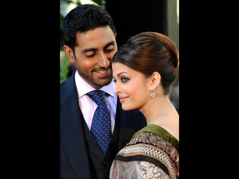 Aishwarya Rai Bachchan (R) and husband Abhishek Bachchan look super adorable as they attend the world premier of the film Raavan in London on June 16, 2010. AFP Photo