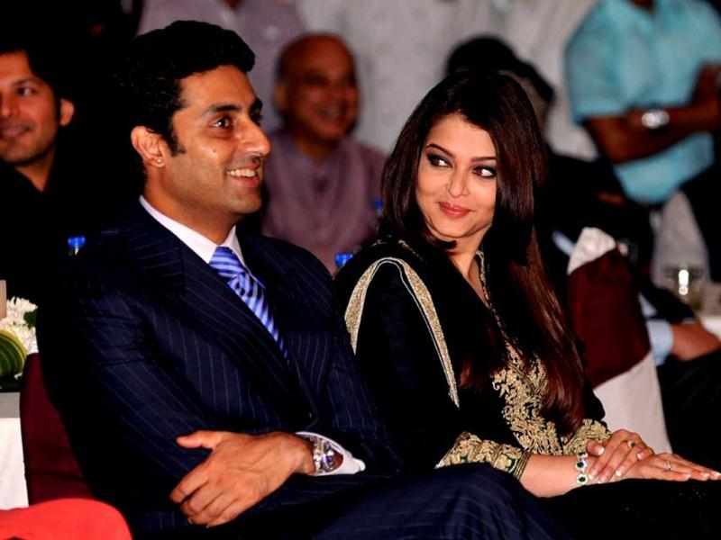 Abhishek Bachchan (L) and his wife Bollywood film actress, Aishwarya Rai Bachchan attend the unveiling of the book My Father, Our Fraternity. AFP Photo