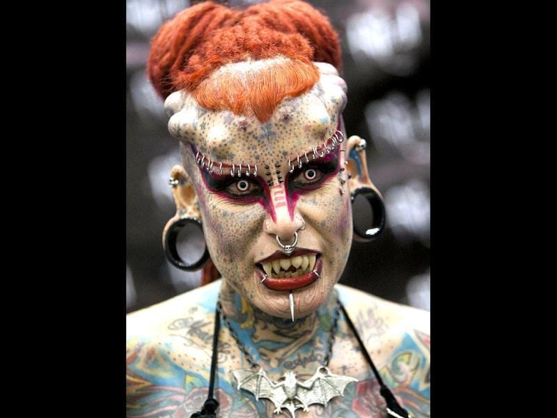 A tattooed woman poses for a picture during the opening of the XV International Tattoo Expo in Monterrey, Mexico. (AFP Photo)