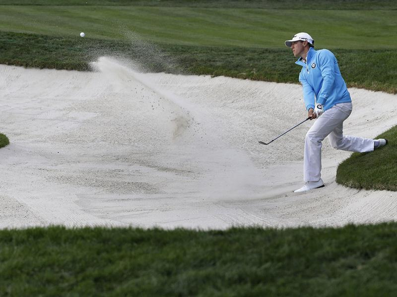 Graham DeLaet of Canada, hits out of a bunker on the 17th hole during the final round of the Honda Classic golf tournament in Palm Beach Gardens, Fla. (AP Photo)