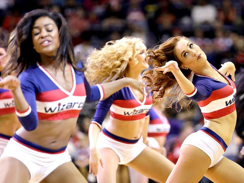 Members of the Washington Wizards Girls preform during the first half of the Wizards and Philadelphia 76ers game at Verizon Center in Washington, DC. (AFP Photo)