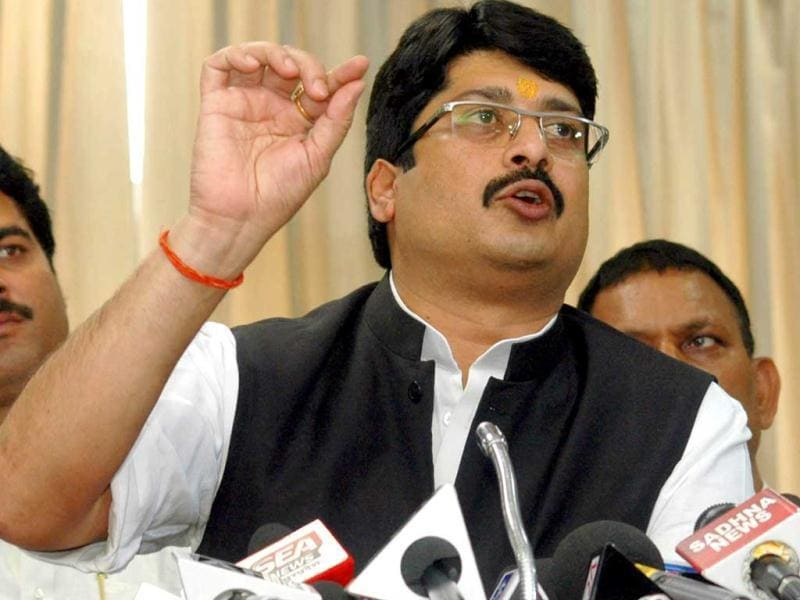 Independent MLA Raghuraj Pratap Singh alias Raja Bhaiya addressing media persons after resigning as Uttar Pradesh food and civil supplies minister at Vidhan Sabha complex in Lucknow. UNI photo