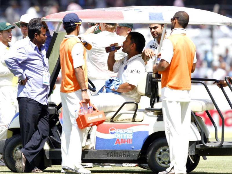 Indian captain and batsman MS Dhoni during drink break during 3rd day of 2nd Test Cricket Match between India and Australia at Rajiv Gandhi International Stadium in Hyderabad. HT Photo/Subhendu Ghosh