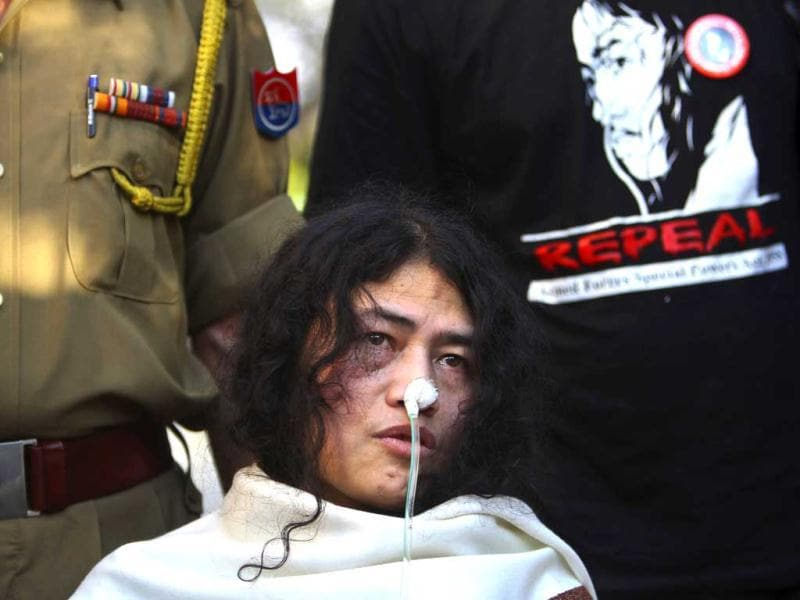 Policeman, left and a supporter stand behind Irom Sharmila, who has been on a hunger strike for 12 years to protest AFSPA in Manipur, speaks during a press conference, in New Delhi. AP Photo
