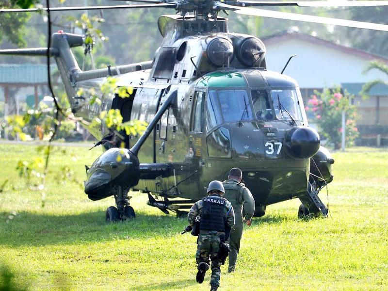 Malaysia Army commandos prepare to board a helicopter to join an assault near the area where a stand-off with Filipino gunmen took place in Tanduo village, Lahad Datu, Sabab, Malaysia. AP/Bernama News Agency