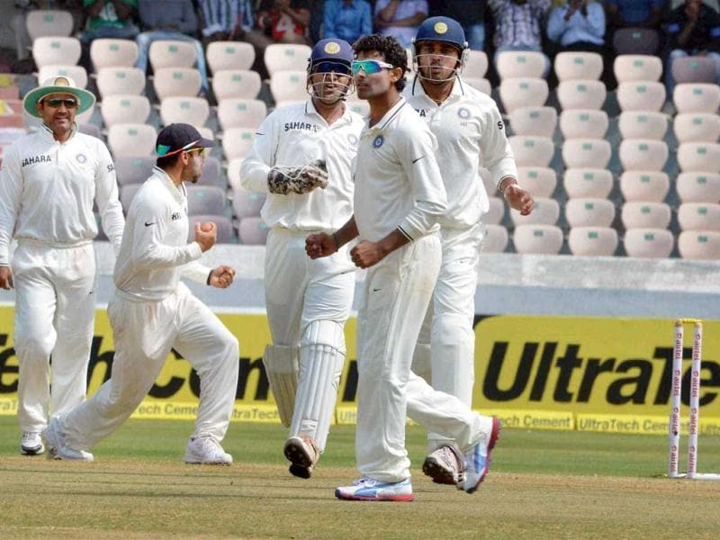 Indian team celebrates the dismissal of MJ Clarke on fourth day of the second Test match against Australia in Hyderabad. PTI