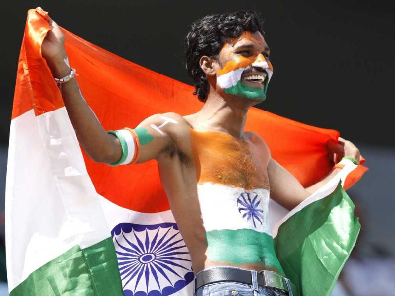A fan with his body painted in the colours of the national flag is seen during the second Test between India and Australia at Rajiv Gandhi International Stadium Hyderabad. HT/Subhendu Ghosh