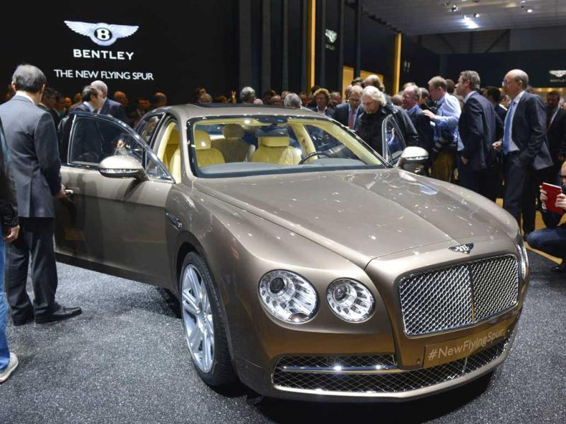 People discover the new Bentley Flying Spur at the Geneva International Motor Show which opens its doors under a dark cloud, with no sign of a speedy rebound in sight for the troubled European market. AFP photo