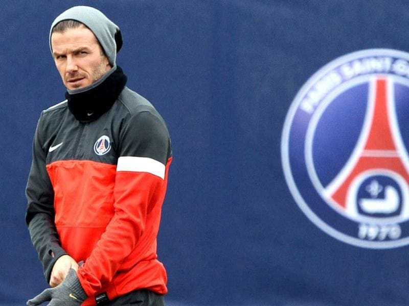 Paris Saint-Germain's English midfielder David Beckham arrives for a training session on March 5, 2013 at the Parc des Princes stadium in Paris, on the eve of an UEFA Champions League round of 16 second leg football match against Valencia. AFP PHOTO