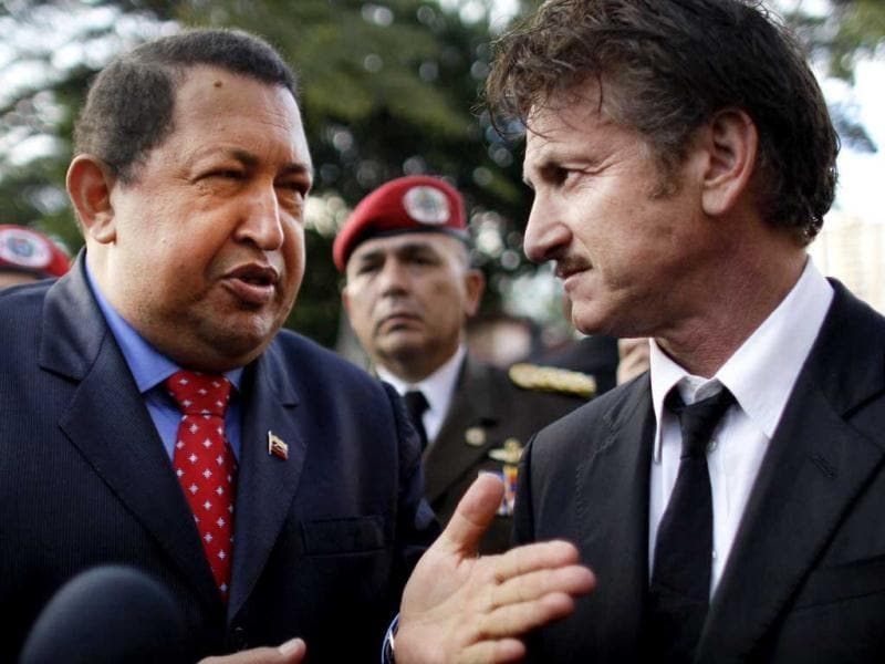 Venezuela's President Hugo Chavez, talks to US actor Sean Penn at the presidential palace in Caracas, Venezuela. (AP)